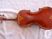 This is a beautiful looking handmade violin by a