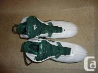 Green and white Nike basketball shoes. Worn only a few