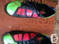 This is a set of green and red Nike T90 soccer cleats.