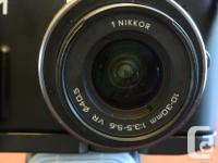 For sale: Used Nikon 1 V1 digital camera in excellent