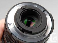 - This compact lens is in beautiful shape and perfect