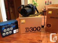 I have a Nikon D300 DSLR with an Nikkor 18-200 mm VR