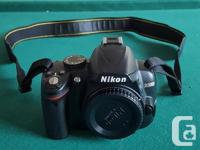 DSLR Nikon D3000 with 18-55mm Nikkor Zoom Lens and