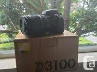 Selling a Nikon D3100 camera with a 18-105mm lens.