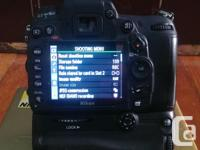 Nikon d7000 body with grip and 2 batteries for $550, or