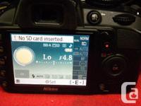 Nikon digital SLR camera with 2 batteries, model D3100,