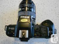 Nikon F-401 auto focus SLR.Sigma auto focus zoom.Lens