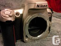 Nikon F-75 in very good condition, no defects, never