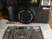 NIKON ONE TOUCH 35mm compact Camera Manual, carrying