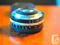 "High quality NIKON series E 50mm f1.8 lens. ""Nifty"