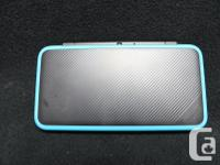 Nintendo 2DS XL with case/charger. Price includes tax.