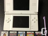 White Nintendo DS Lite and five video games. Good