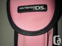 Royal Blue Nintendo DS with a pink carry case and 17