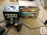Gamecube console, controller, memory card, 10 video