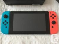 EUC Nintendo Switch game console. Comes with 2