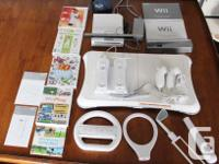 Included : Wii console Sensor bar with stand Two