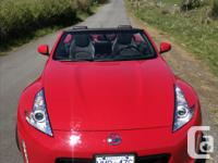 Make Nissan Model 350Z Roadster Year 2013 Colour RED