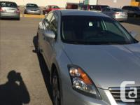Make Nissan Model Altima Colour Grey Trans Automatic