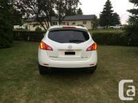 Make Nissan Model Murano Year 2009 Colour white pearl