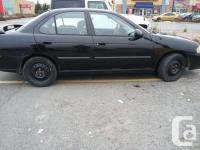 Make Nissan Design Sentra Year 2001 Colour Black kms