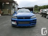 Make. Nissan. Design. GT-R. Year. 1999. Colour. BLUE.