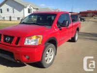 Make. Nissan. Version. Titan. Year. 2008. Colour. Red.