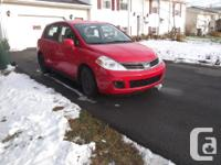 Make Nissan Model Versa Year 2009 Colour red kms