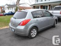 Make Nissan Model Versa Year 2009 Colour Silver kms
