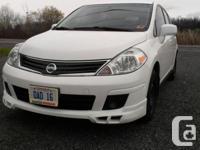 Make. Nissan. Version. Versa Hatchback. Year. 2011.