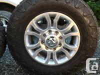 Set of four Nitto Grapplers on Ram 3500 Rims. Tires are