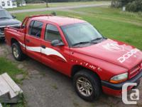 Make. Dodge. Model. Dakota. Year. 2001. Colour. Red.