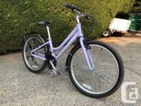"Purple. Almost new aluminum road bike. 24"" tires,"