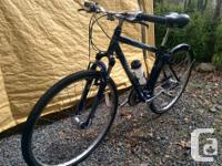 Norco Vermont hybrid with 700c wheels, suspension fork