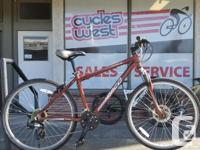 This here is a used norco pinnacle hybrid style bike.