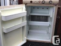 I have an Norcold Rv/Camper refrigerator. Works on lp,