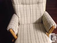 Beige color nursing chair, slide, could lock into