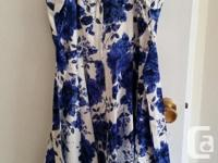 Retro-style white and blue floral short dress. Has full