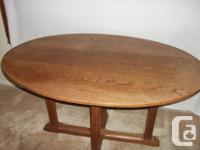 Oak oval-shaped hall/library table, in the Sidney