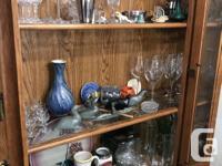 Oak buffet and hutch. Glass shelves inside hutch. Solid