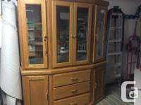 Solid oak buffet and hutch, glass shelves. Excellent