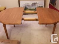 Oak dining room table with leaf and 6 chairs $150.00