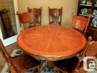 Oak dining set with 48 inches round pedestal table with