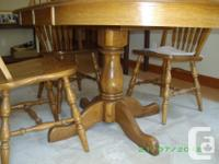 "Solid Oak Table 40"" round, 30"" high, with 2 leaves for sale  British Columbia"