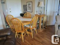 """Oak,42 inch round table, with an 18"""" leaf, extends to"""