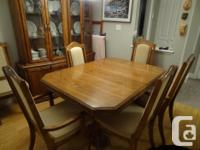 Lovely oak set with 6 recently upholstered chairs.