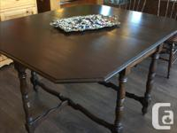 A very useful oak table that is narrow when the drop for sale  British Columbia