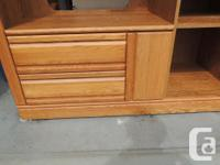 Solid oak entertainment centre, holds TV and stereo