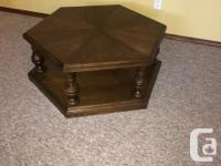 "Oak finished hexagonal coffee table 18"" high by 32"""