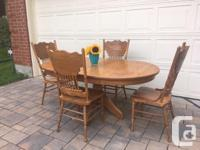 Sturdy, solid wood table with 2 leaves and 4 matching
