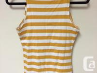 Featuring orange and white diagonal stripes with subtle